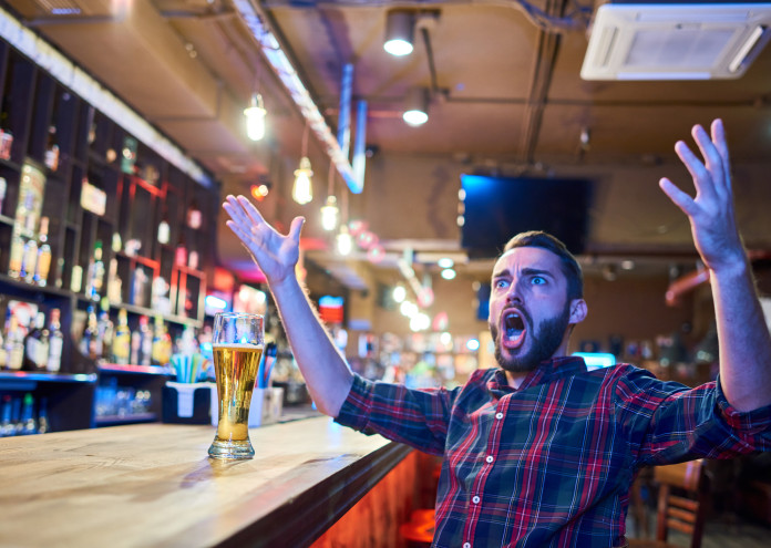 Emotional Sports Fan in Pub