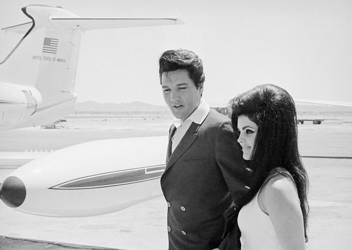 Elvis and Priscilla Presley at Airplane Door