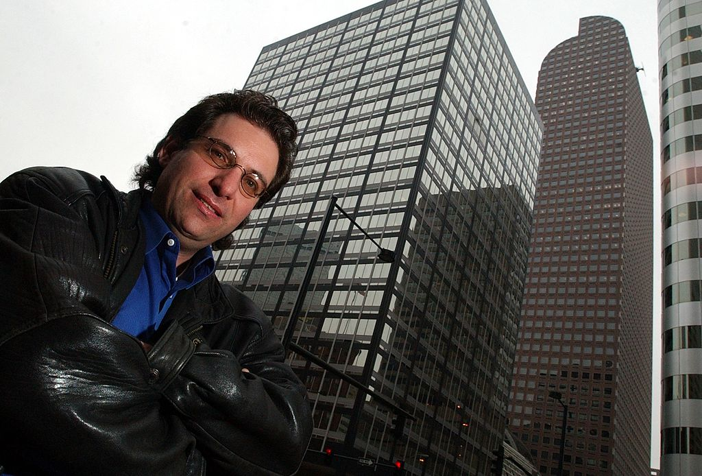 Kevin Mitnick, the worlds most notorious hacker poses for a portrait outside the Cash register building in downtown Denver where he worked under the alias id Eric Weiss at the Law firm of Holme, Roberts and Owen. (Craig F. Walker / The Denver Post)
