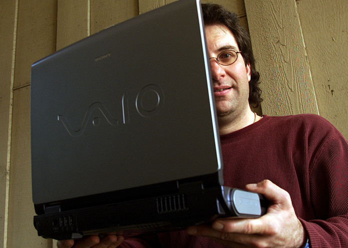 Thousand Oaks resident Kevin Mitnick, 39, holds up his Sony laptop notebook computer. Mitnick is a c