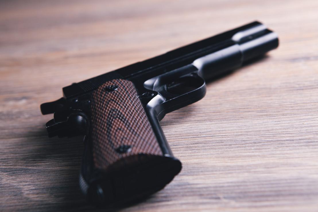 black pistol lying on the table
