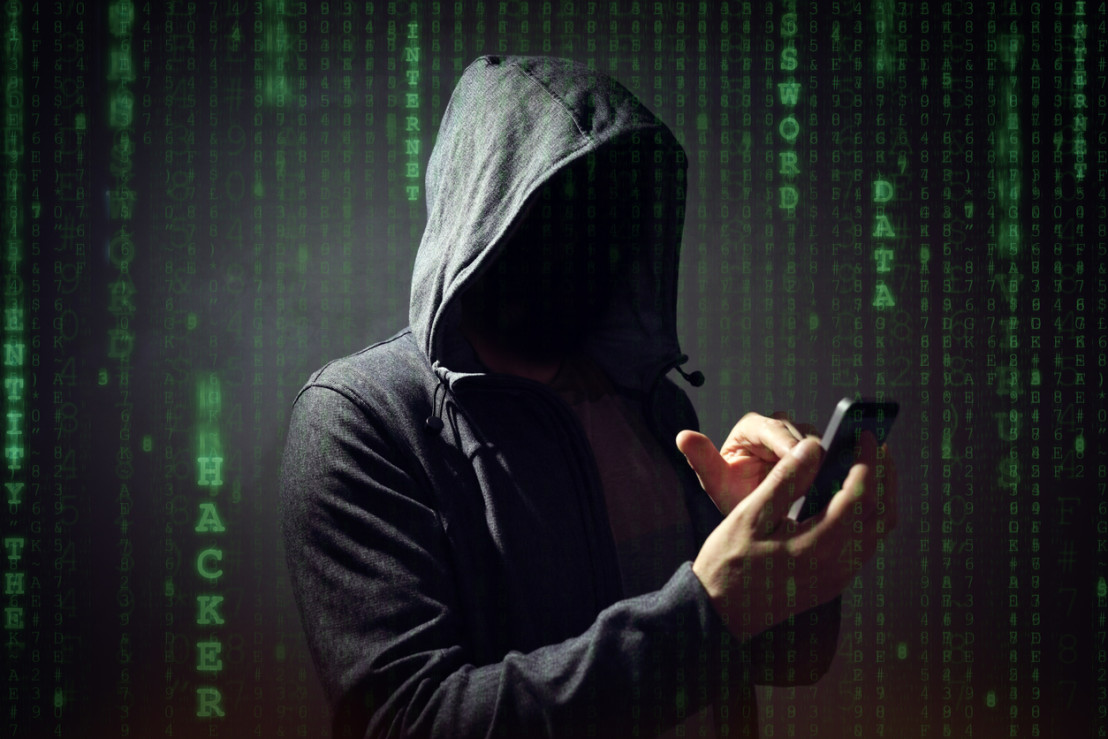 Computer hacker with mobile phone
