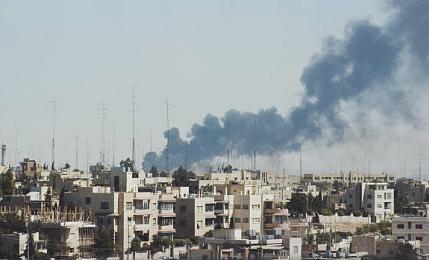 Smoke_rises_above_Amman_during_Black_September,_1_October_1970